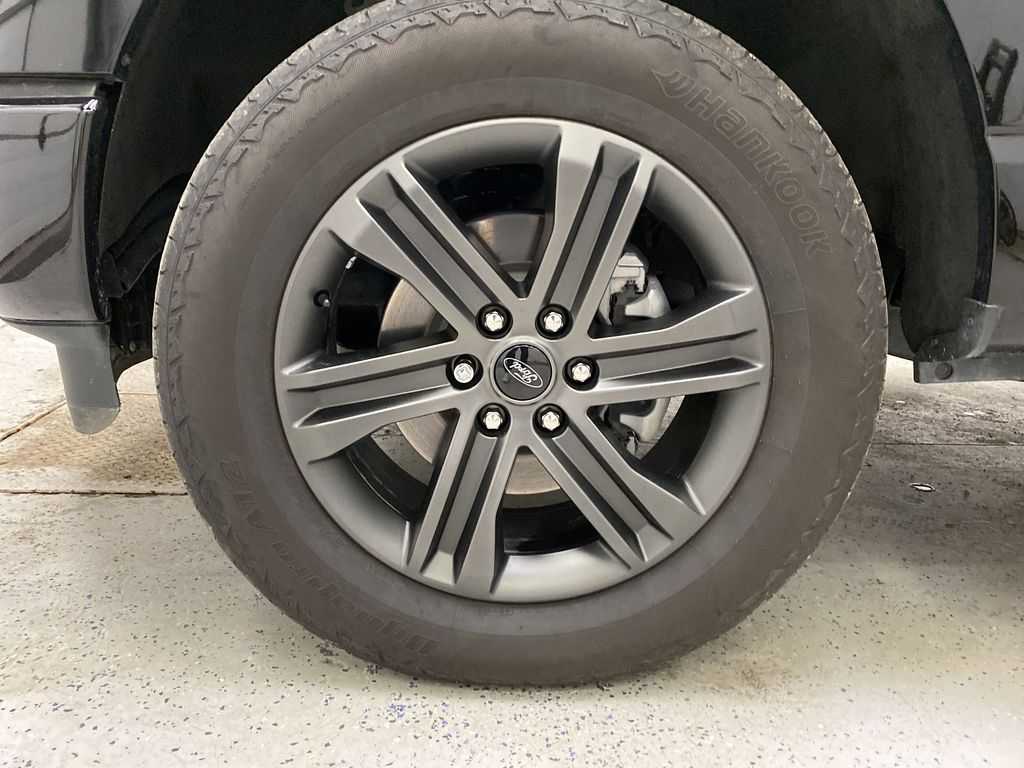 Black[Agate Black Metallic] 2021 Ford F-150 Left Front Rim and Tire Photo in Dartmouth NS