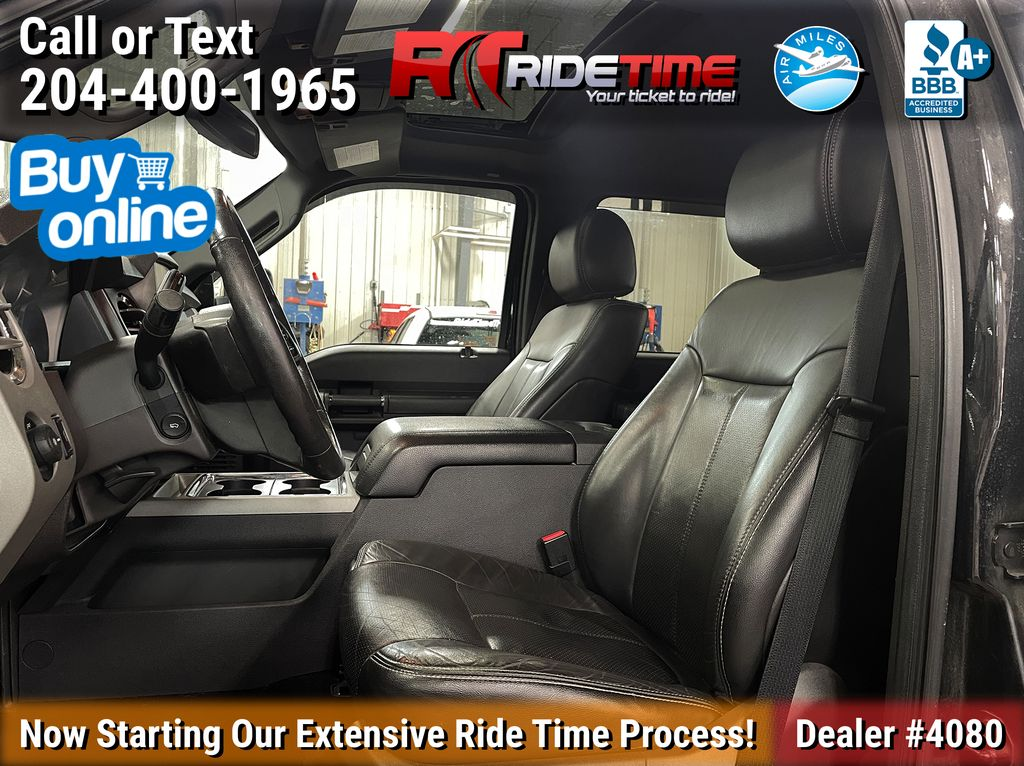Black[Tuxedo Black Metallic] 2014 Ford F-250 Lariat 4WD - SuperCrew, Leather, Sunroof, Navigation Left Front Interior Photo in Winnipeg MB