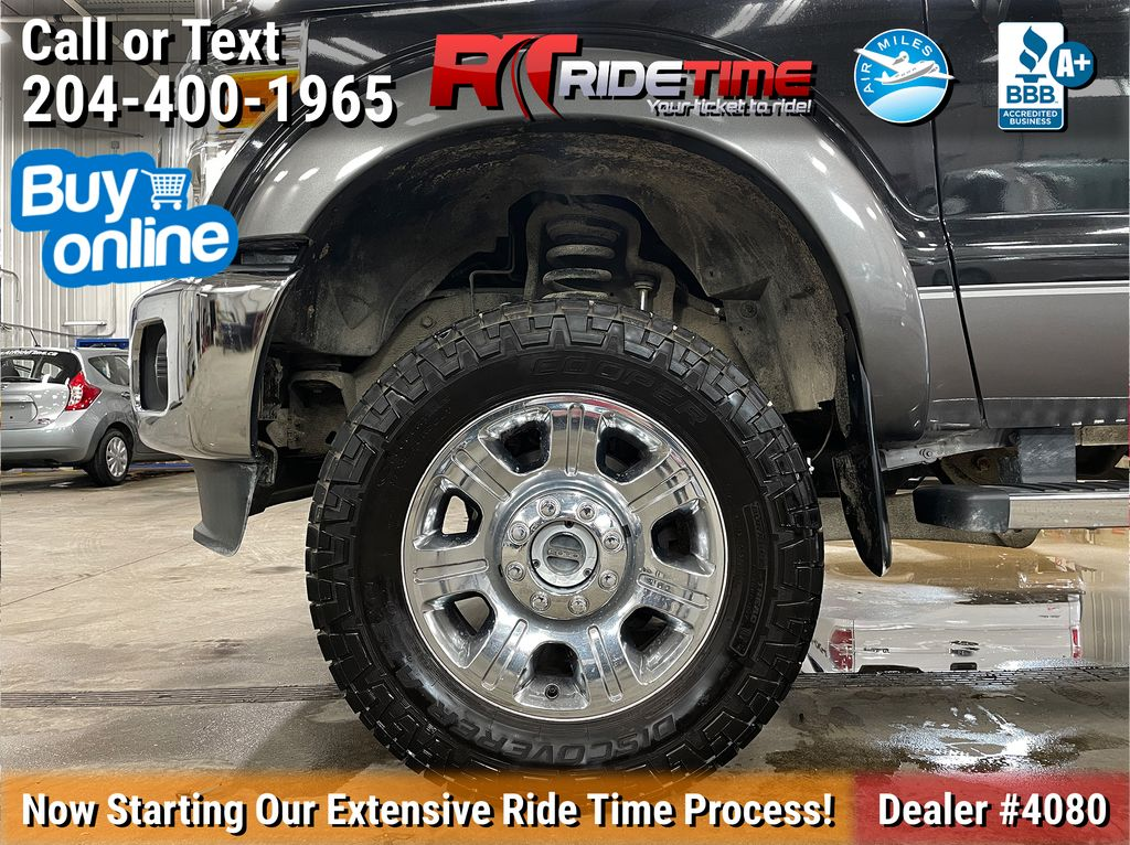 Black[Tuxedo Black Metallic] 2014 Ford F-250 Lariat 4WD - SuperCrew, Leather, Sunroof, Navigation Left Front Rim and Tire Photo in Winnipeg MB