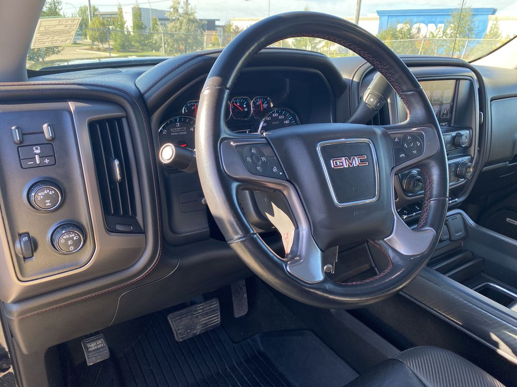 Gray[Dark Slate Metallic] 2018 GMC Sierra 1500 Steering Wheel and Dash Photo in Edmonton AB