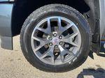 Gray[Dark Slate Metallic] 2018 GMC Sierra 1500 Left Front Rim and Tire Photo in Edmonton AB