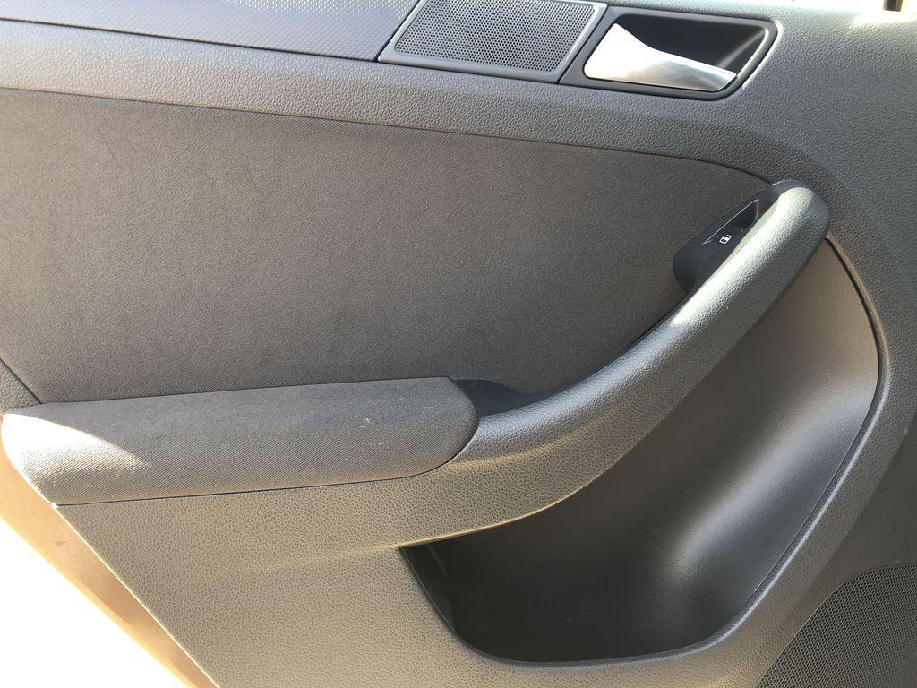 Brown[Toffee Brown Metallic] 2012 Volkswagen Jetta Sedan Left Rear Interior Door Panel Photo in Edmonton AB