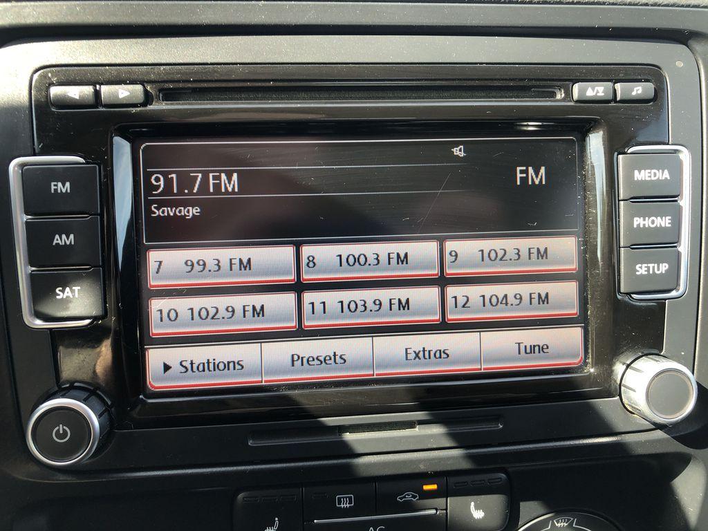 Brown[Toffee Brown Metallic] 2012 Volkswagen Jetta Sedan Radio Controls Closeup Photo in Edmonton AB