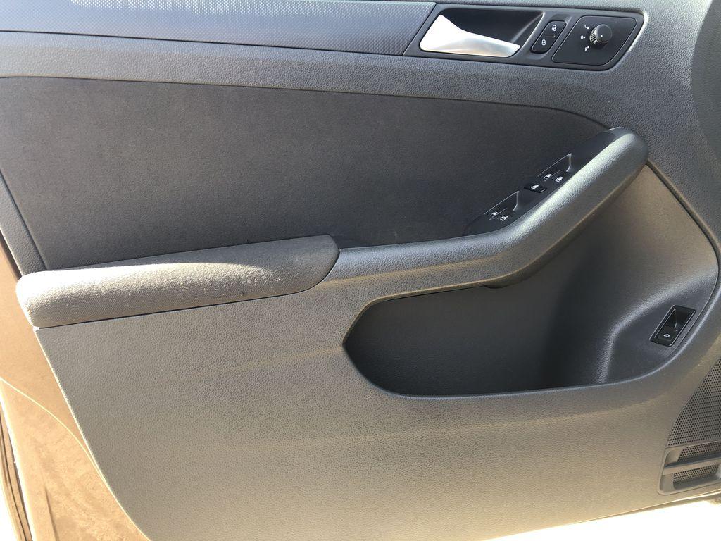 Brown[Toffee Brown Metallic] 2012 Volkswagen Jetta Sedan Left Front Interior Door Panel Photo in Edmonton AB