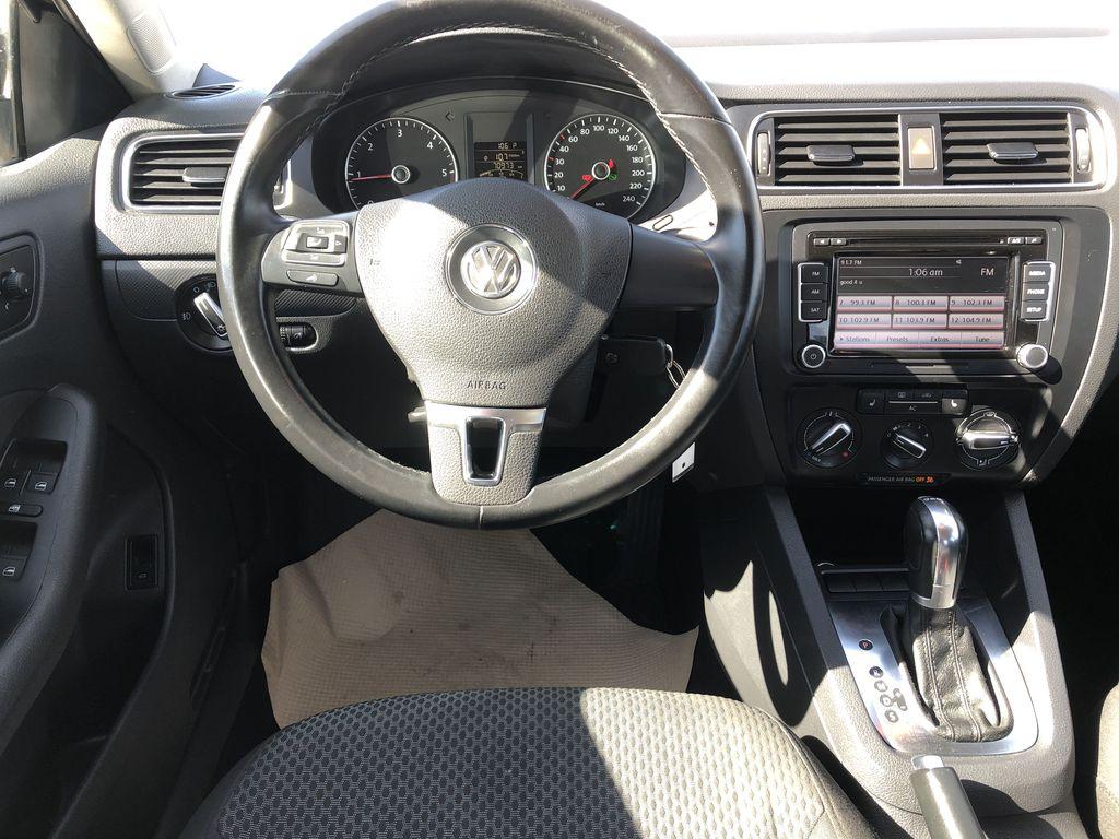 Brown[Toffee Brown Metallic] 2012 Volkswagen Jetta Sedan Strng Wheel/Dash Photo: Frm Rear in Edmonton AB