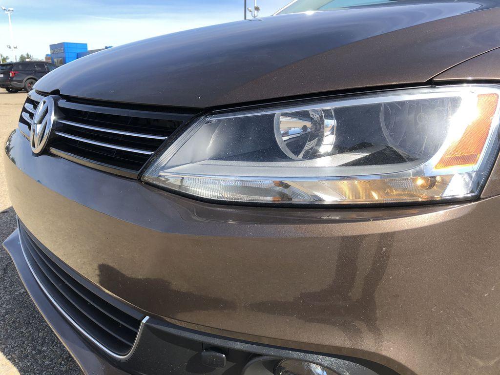 Brown[Toffee Brown Metallic] 2012 Volkswagen Jetta Sedan Left Front Head Light / Bumper and Grill in Edmonton AB