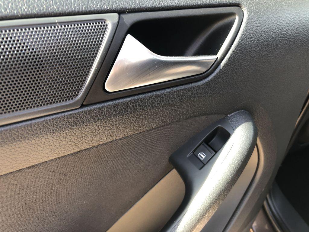 Brown[Toffee Brown Metallic] 2012 Volkswagen Jetta Sedan LR Door Panel Ctls Photo in Edmonton AB