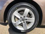Brown[Toffee Brown Metallic] 2012 Volkswagen Jetta Sedan Left Front Rim and Tire Photo in Edmonton AB