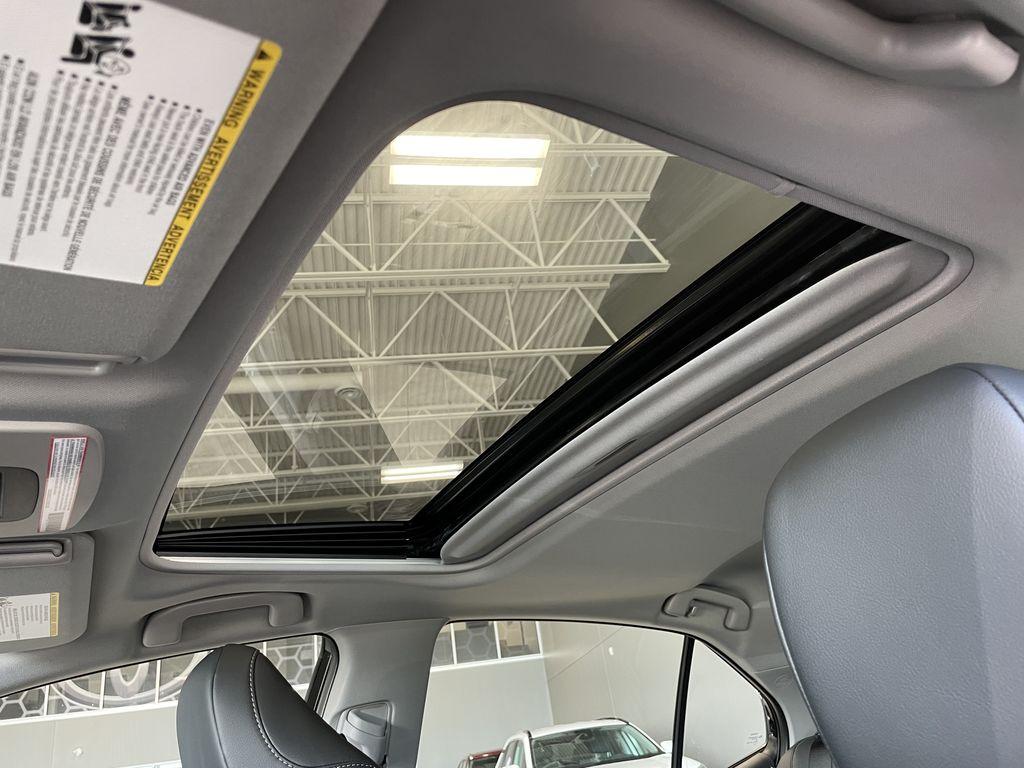 Midnight Black Metallic 2021 Toyota Camry SE AWD Nightshade Engine Compartment Photo in Edmonton AB