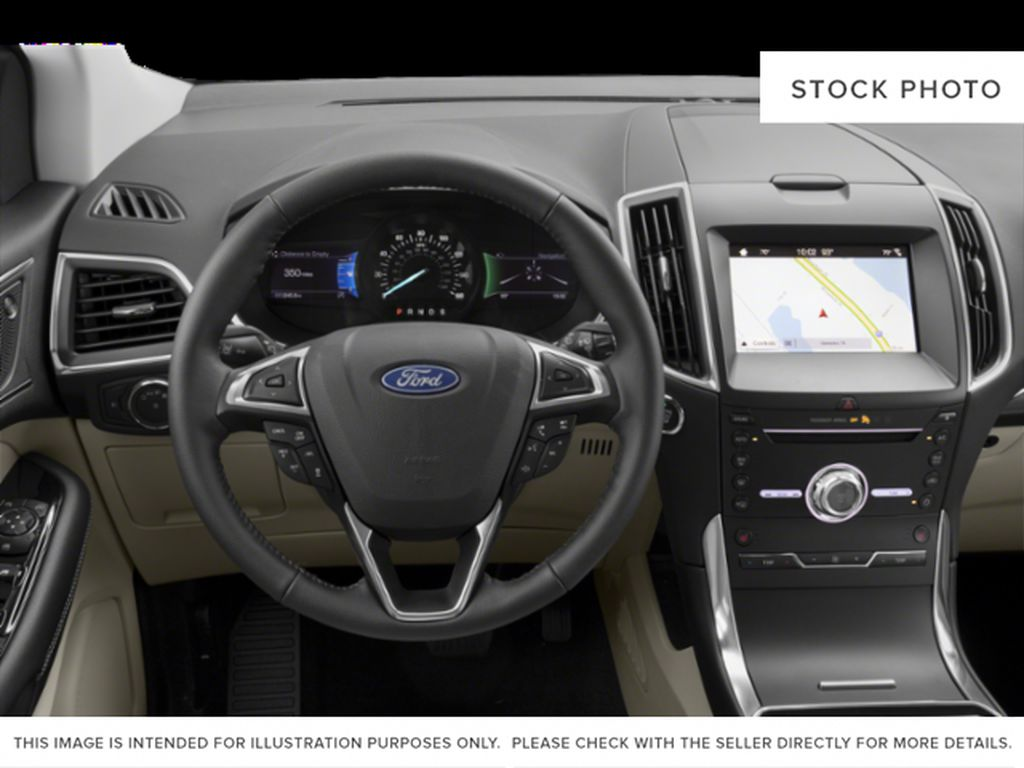 White[Oxford White] 2019 Ford Edge Steering Wheel and Dash Photo in Fort Macleod AB