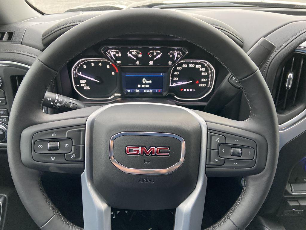 Black[Onyx Black] 2021 GMC Sierra 1500 AT4 Steering Wheel and Dash Photo in Calgary AB