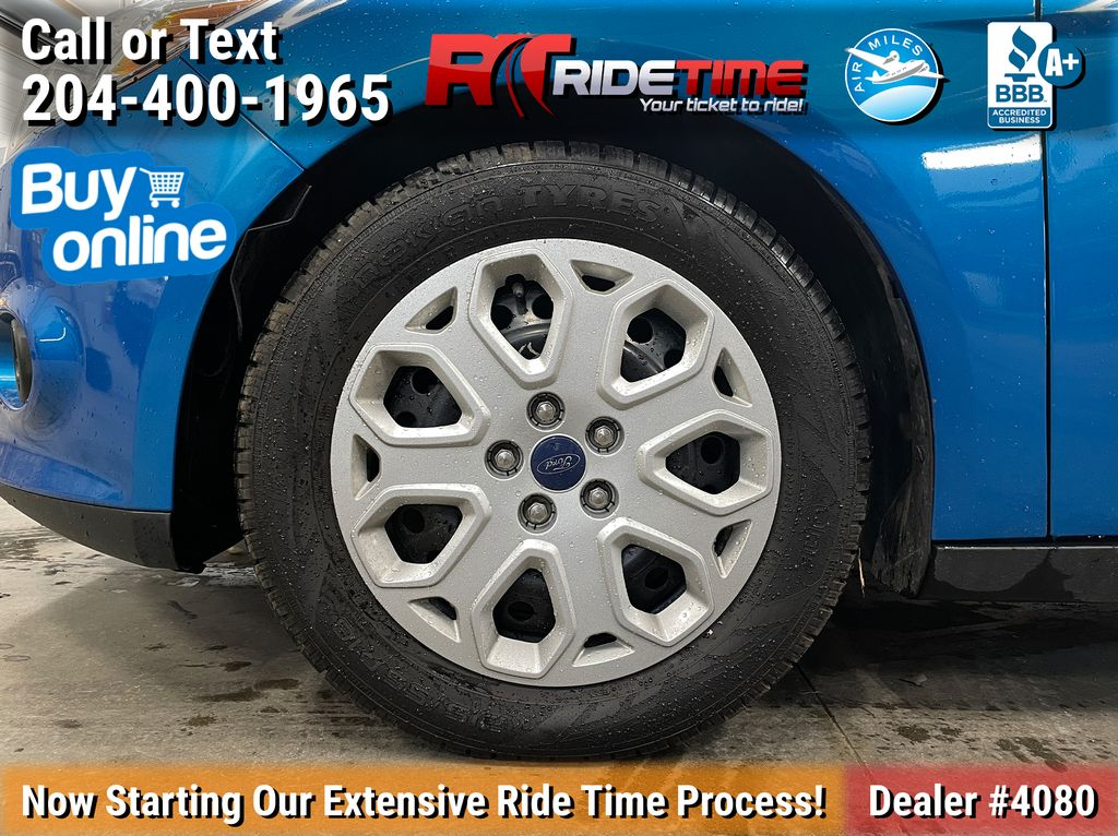 Blue[Blue Candy Tinted Clearcoat] 2014 Ford Focus SE Sedan - AUTO, Heated Seats, Bluetooth, LOW KMs Left Front Rim and Tire Photo in Winnipeg MB