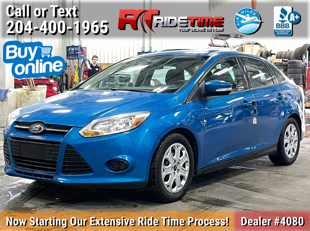 Blue[Blue Candy Tinted Clearcoat] 2014 Ford Focus SE Sedan - AUTO, Heated Seats, Bluetooth, LOW KMs