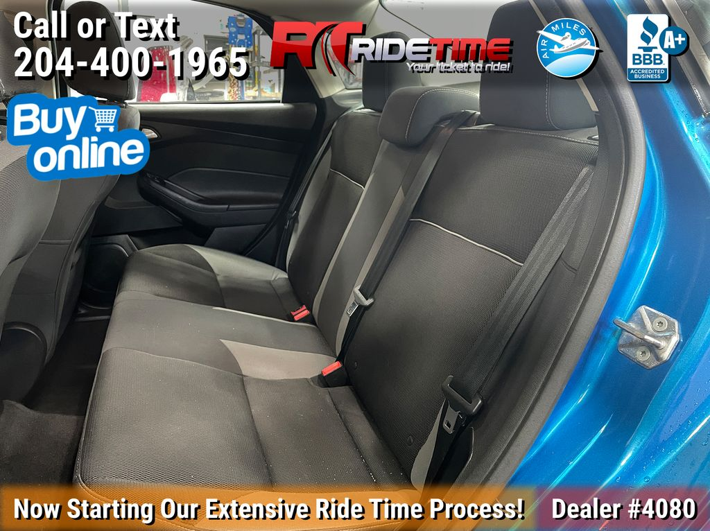 Blue[Blue Candy Tinted Clearcoat] 2014 Ford Focus SE Sedan - AUTO, Heated Seats, Bluetooth, LOW KMs Left Side Rear Seat  Photo in Winnipeg MB
