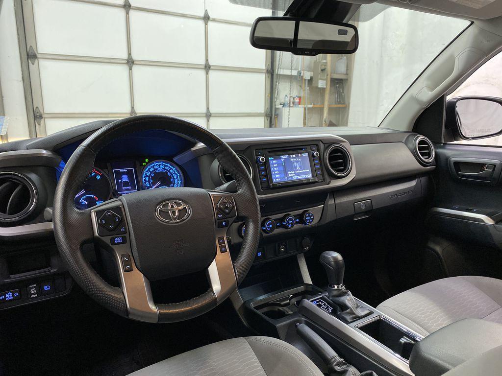 Gray[Cement Grey Metallic] 2019 Toyota Tacoma Strng Wheel/Dash Photo: Frm Rear in Dartmouth NS