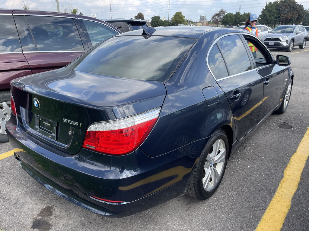 Black[Black Sapphire Metallic] 2010 BMW 5 Series clean Left Front Interior Photo in Brampton ON