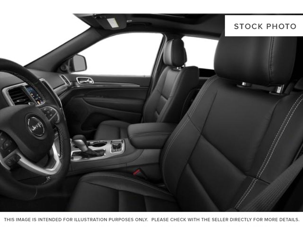 White[Bright White] 2021 Jeep Grand Cherokee Left Front Interior Photo in Fort Macleod AB