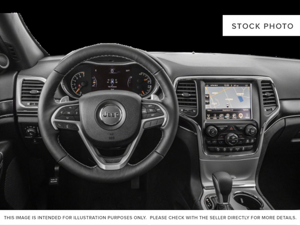 Red[Velvet Red Pearl] 2021 Jeep Grand Cherokee Steering Wheel and Dash Photo in Fort Macleod AB