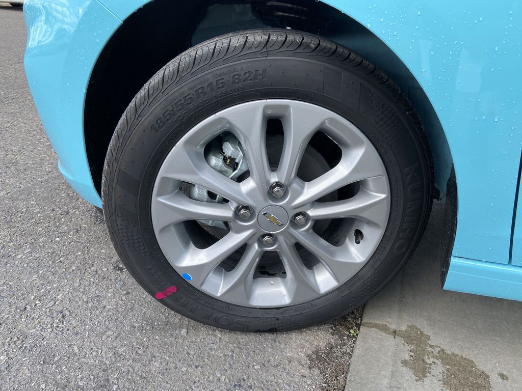 Blue[Mystic Blue] 2022 Chevrolet Spark LT Left Front Rim and Tire Photo in Calgary AB