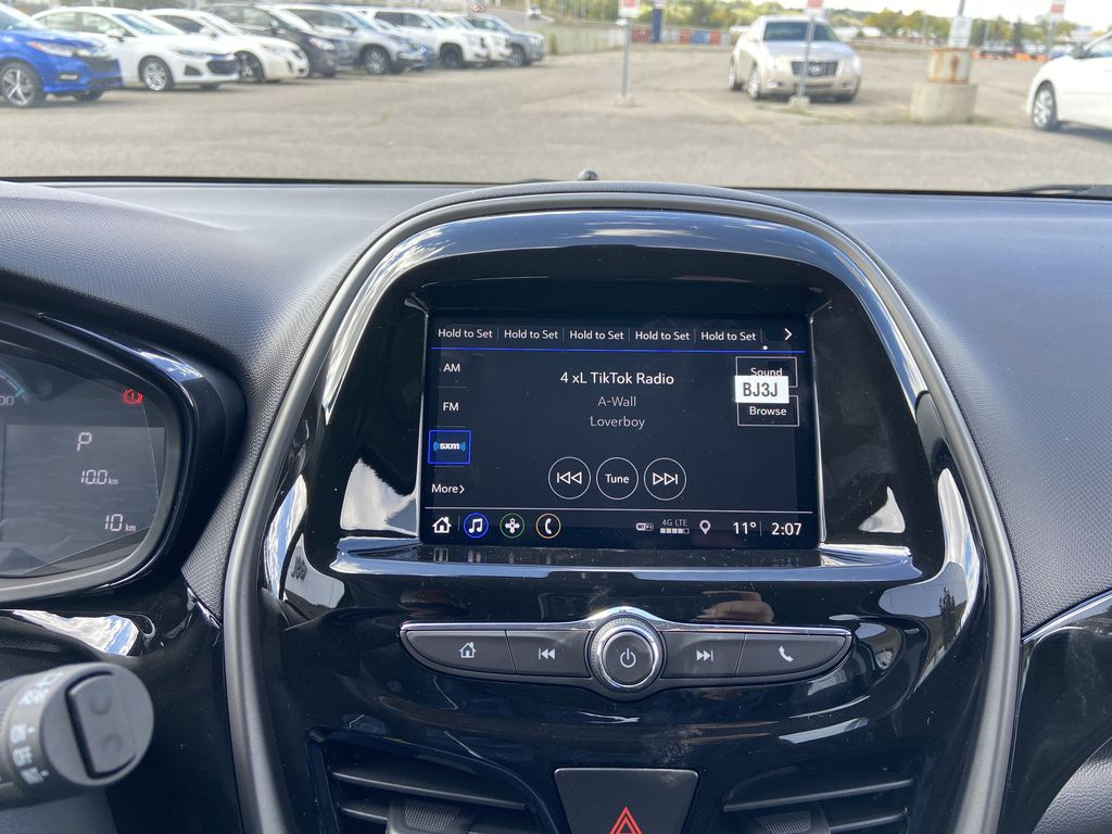 Blue[Mystic Blue] 2022 Chevrolet Spark LT Radio Controls Closeup Photo in Calgary AB