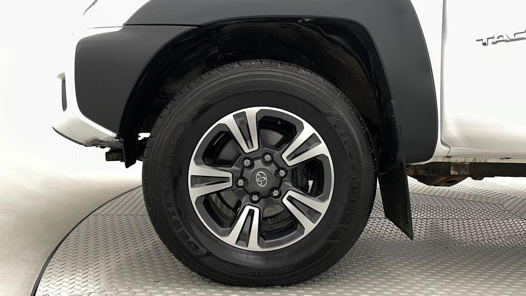 White[Alpine White] 2012 Toyota Tacoma Base 4WD - Double Cab, 4.0L V6, Fiberglass Tonneau Left Front Rim and Tire Photo in Winnipeg MB