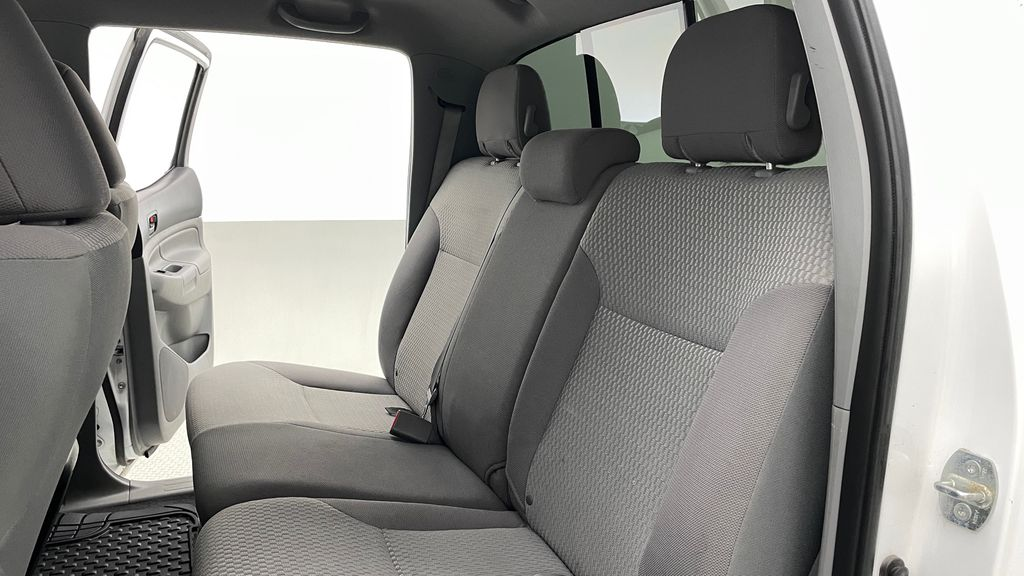 White[Alpine White] 2012 Toyota Tacoma Base 4WD - Double Cab, 4.0L V6, Fiberglass Tonneau Left Side Rear Seat  Photo in Winnipeg MB