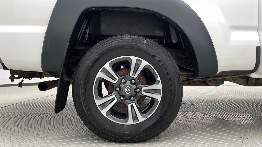 White[Alpine White] 2012 Toyota Tacoma Base 4WD - Double Cab, 4.0L V6, Fiberglass Tonneau Right Rear Rim and Tire Photo in Winnipeg MB