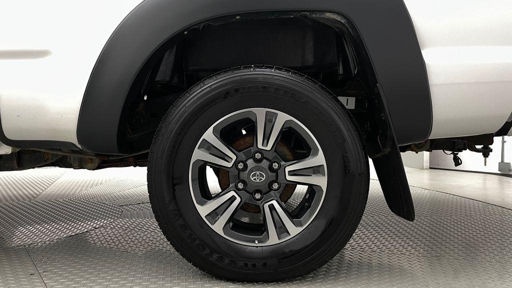 White[Alpine White] 2012 Toyota Tacoma Base 4WD - Double Cab, 4.0L V6, Fiberglass Tonneau Left Rear Rim and Tire Photo in Winnipeg MB