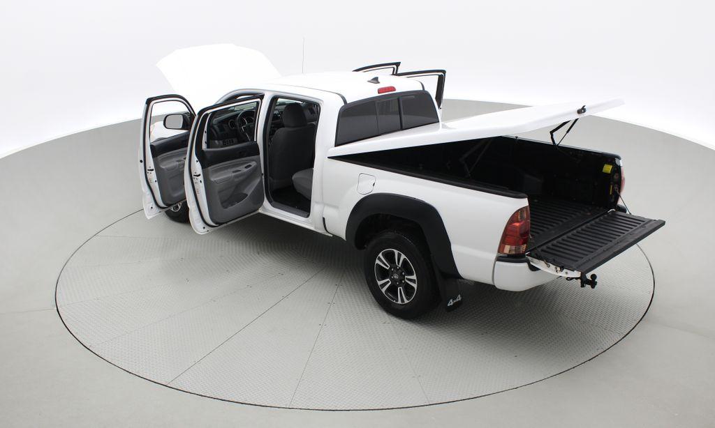 White[Alpine White] 2012 Toyota Tacoma Base 4WD - Double Cab, 4.0L V6, Fiberglass Tonneau Right  Rear Corner Photo in Winnipeg MB