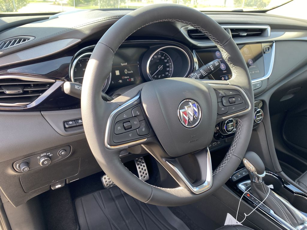 Gray[Satin Steel Metallic] 2022 Buick Encore GX Steering Wheel and Dash Photo in Edmonton AB