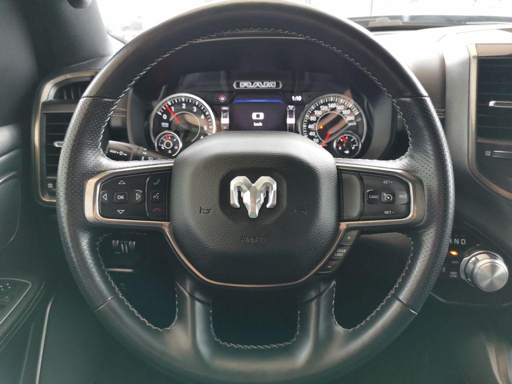 Black[Diamond Black Crystal Pearl] 2021 Ram 1500 Steering Wheel and Dash Photo in Edmonton AB