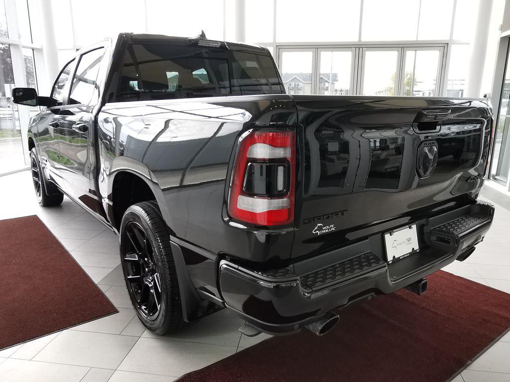 Black[Diamond Black Crystal Pearl] 2021 Ram 1500 Left Rear Corner Photo in Edmonton AB