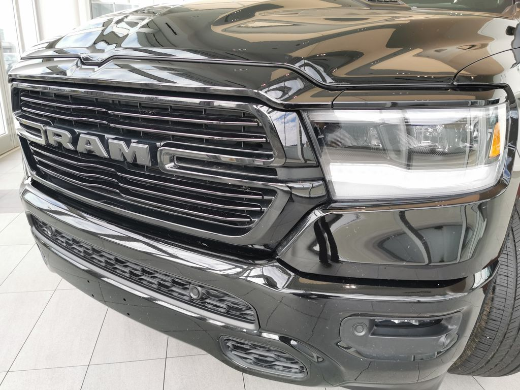 Black[Diamond Black Crystal Pearl] 2021 Ram 1500 Left Front Head Light / Bumper and Grill in Edmonton AB