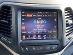 White[Bright White Clearcoat] 2014 Jeep Cherokee Radio Controls Closeup Photo in Edmonton AB