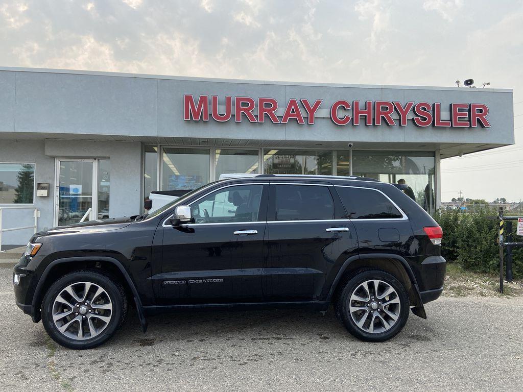Black[Diamond Black Crystal Pearl] 2018 Jeep Grand Cherokee Left Side Photo in Brandon MB