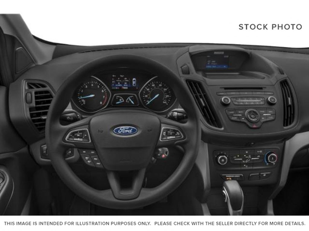 Silver[Ingot Silver] 2019 Ford Escape Steering Wheel and Dash Photo in Fort Macleod AB