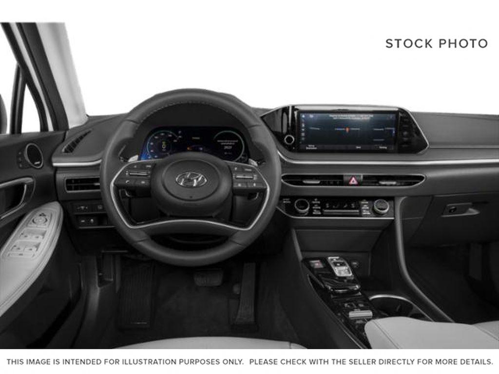 Silver[Shimmering Silver] 2022 Hyundai Sonata Hybrid Steering Wheel and Dash Photo in Ottawa ON