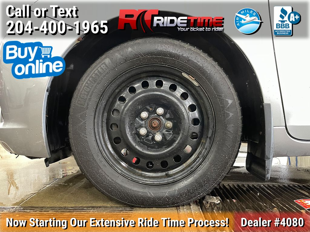Gray[Pre-Dawn Grey Mica] 2015 Toyota Sienna Base - 7 Passenger Left Front Rim and Tire Photo in Winnipeg MB
