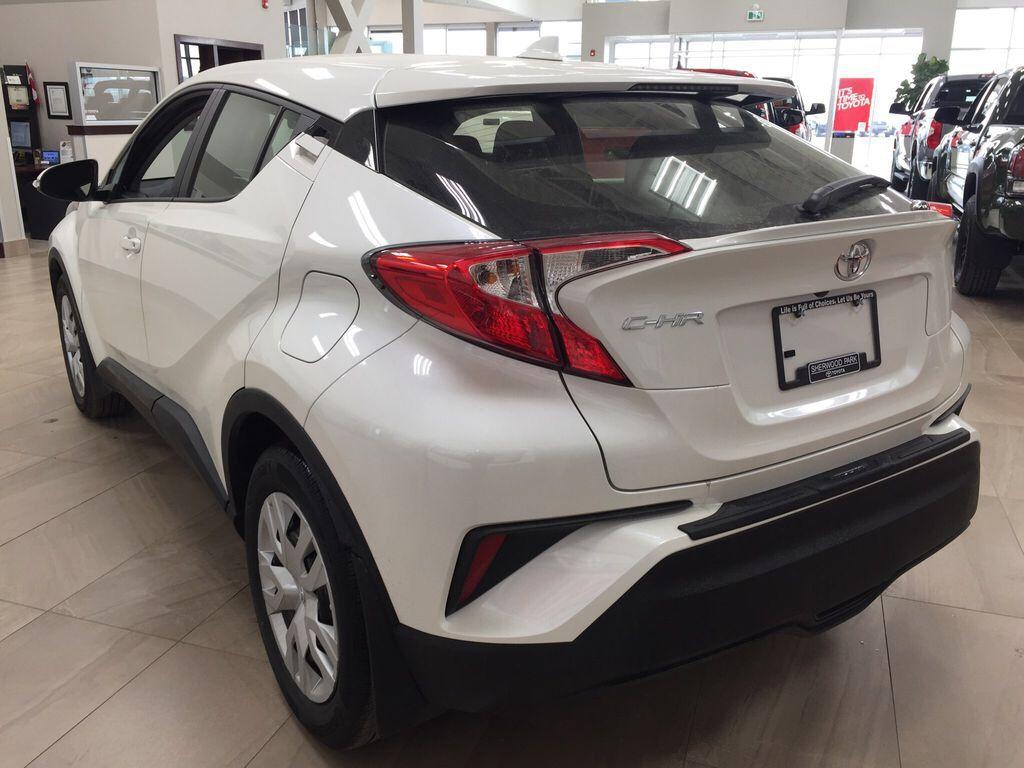 White[Blizzard Pearl] 2021 Toyota C-HR LE Left Rear Corner Photo in Sherwood Park AB