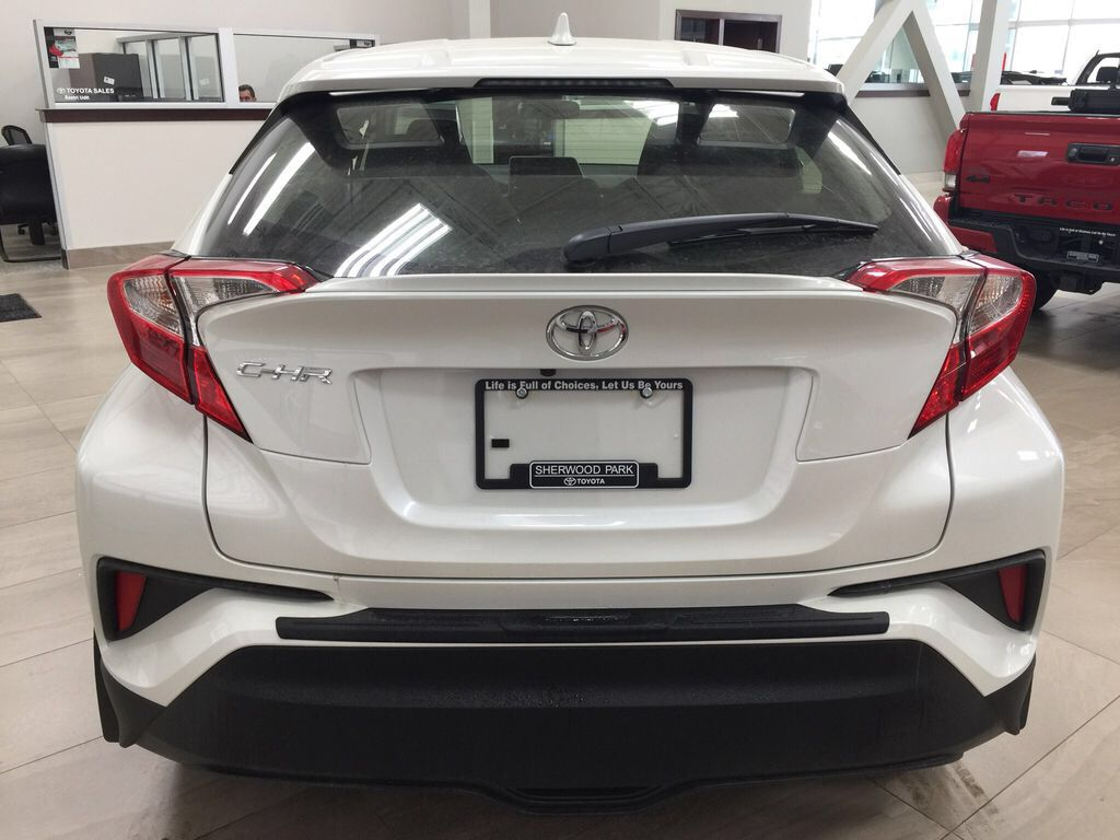 White[Blizzard Pearl] 2021 Toyota C-HR LE Rear of Vehicle Photo in Sherwood Park AB