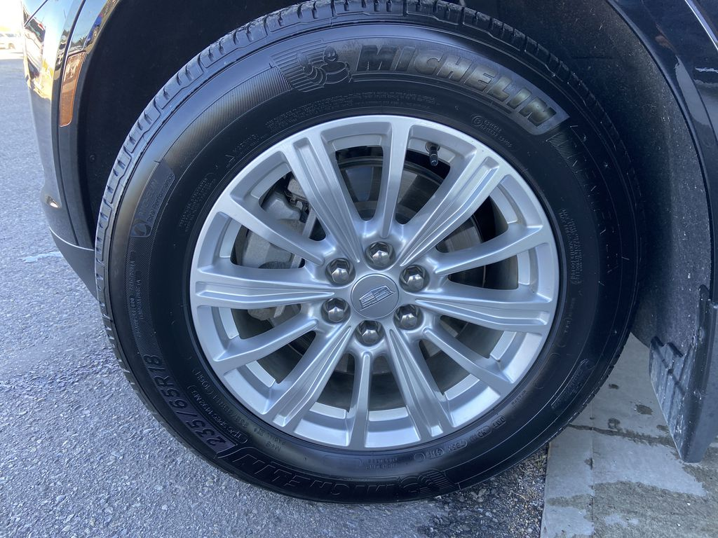 Black[Manhattan Noir Metallic] 2019 Cadillac XT5 Left Front Rim and Tire Photo in Calgary AB