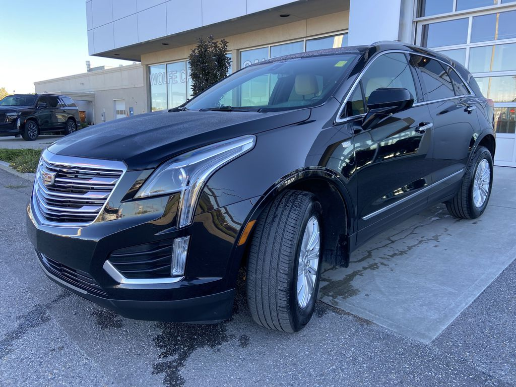 Black[Manhattan Noir Metallic] 2019 Cadillac XT5 Left Front Head Light / Bumper and Grill in Calgary AB