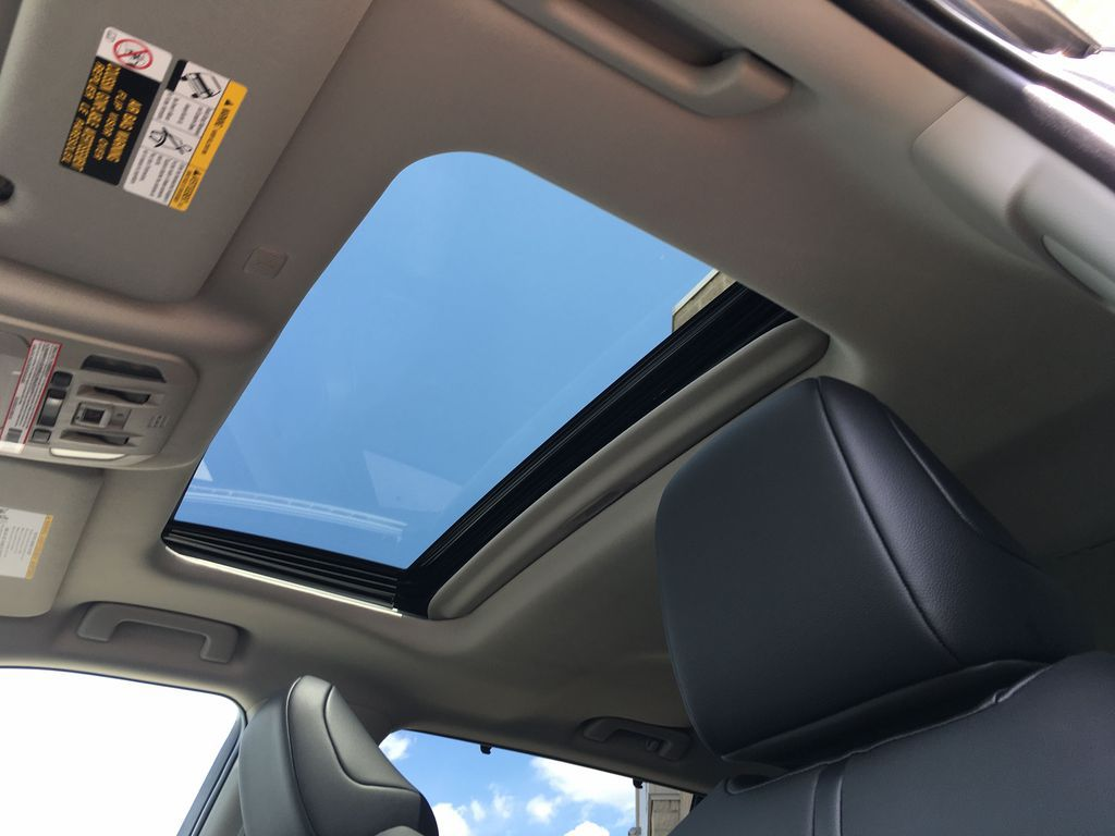 Gray[Magnetic Grey Metallic] 2021 Toyota Highlander AWD XLE Package GZRBHT AM Center Console Photo in Brampton ON