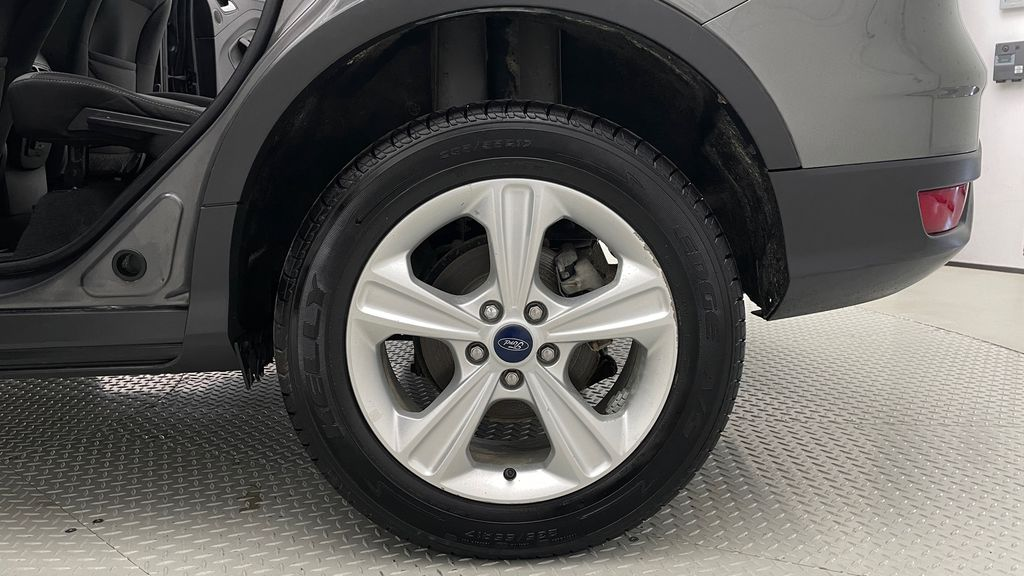 Gray[Sterling Grey Metallic] 2013 Ford Escape SE 4WD - 2.0L EcoBoost, Heated Seats, Alloy Wheels Left Rear Rim and Tire Photo in Winnipeg MB