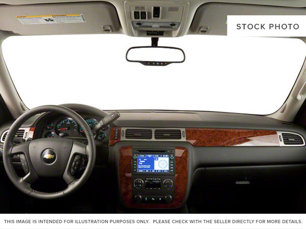 Silver[Silver Ice Metallic] 2013 Chevrolet Silverado 1500 Steering Wheel and Dash Photo in Brandon MB