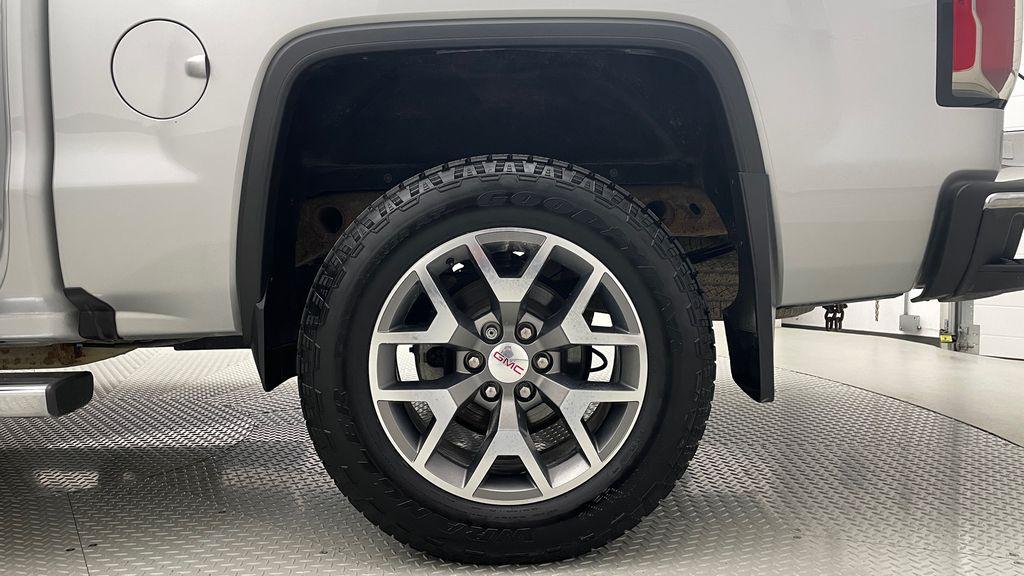 Silver[Quicksilver Metallic] 2017 GMC Sierra 1500 SLT Z71 4WD - Crew Cab, 5.3L, LOW KMs Left Rear Rim and Tire Photo in Winnipeg MB
