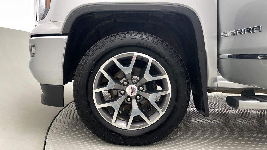 Silver[Quicksilver Metallic] 2017 GMC Sierra 1500 SLT Z71 4WD - Crew Cab, 5.3L, LOW KMs Left Front Rim and Tire Photo in Winnipeg MB