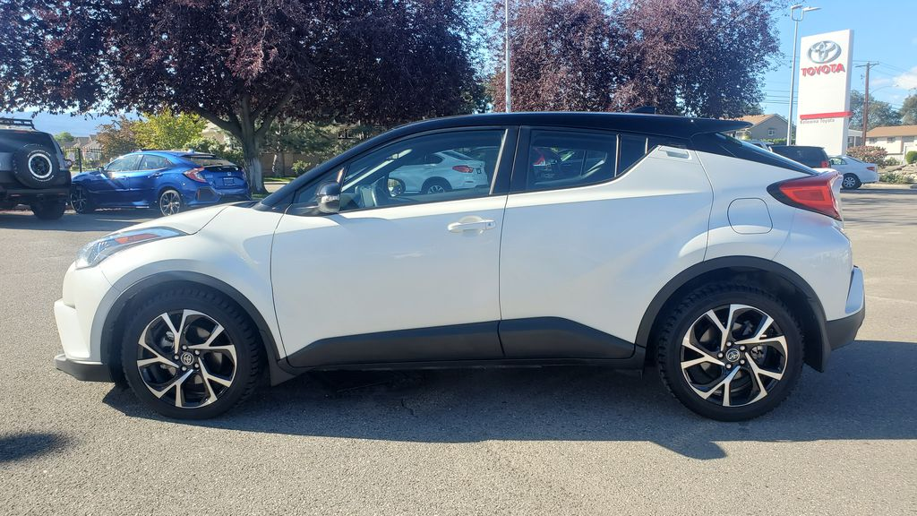 White[Blizzard Pearl with Black Roof] 2019 Toyota C-HR Left Side Photo in Kelowna BC