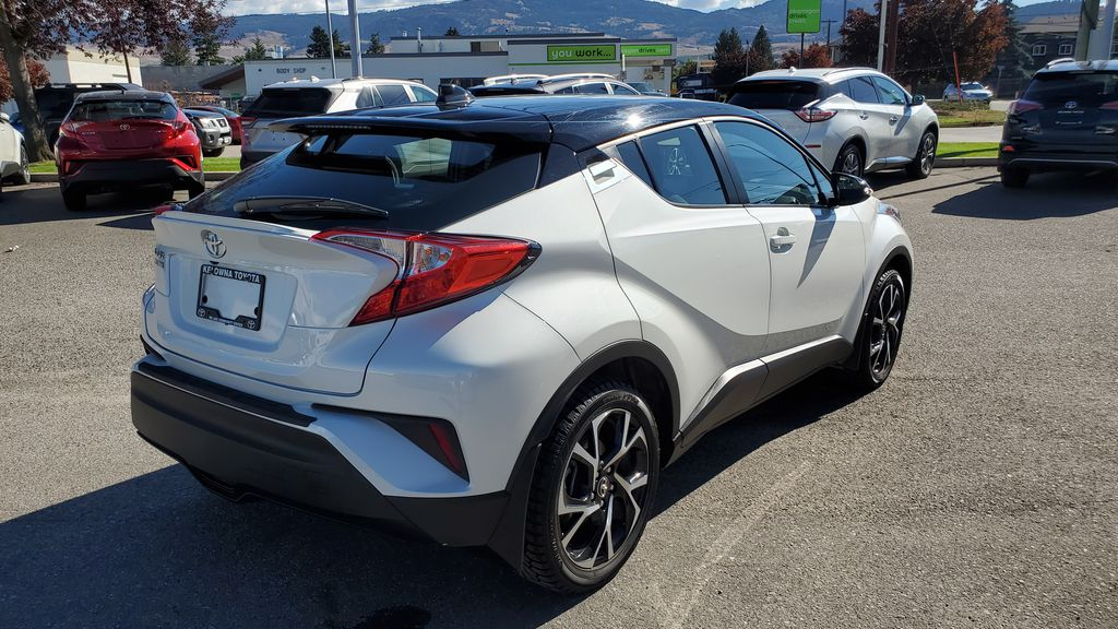 White[Blizzard Pearl with Black Roof] 2019 Toyota C-HR Right Rear Corner Photo in Kelowna BC