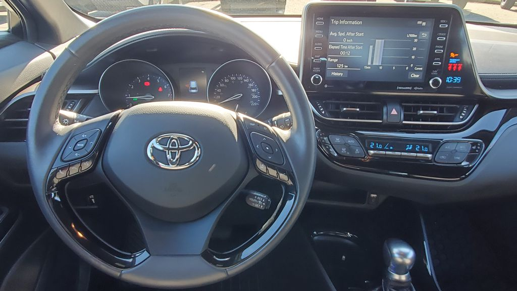 White[Blizzard Pearl with Black Roof] 2019 Toyota C-HR Steering Wheel and Dash Photo in Kelowna BC